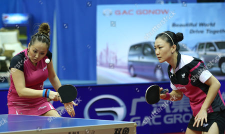 Xiaona Shan (r) and Zhenqi Barthel (l) of Germany in Action Against Huang Yi-hua and Cheng I-ching From Chinese Taipei During Their Women's Doubles Semi-final Match For the Gac Group Ittf World Tour Grand Finals at Al-nasr Club in the Gulf Emirate of Dubai United Arab Emirates 12 January 2014 # United Arab Emirates Dubai