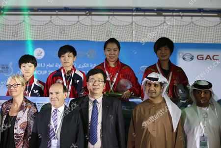 China's Li Xiaoxia (rear-2r) and Ding Ning (rear-r) Pose with Officials After Winning Against Chinese Taipei Huang Yi-hua (rear-l) and Cheng I-ching (rear-2-l) After the Final of Women's Doubles at Gac Group Ittf World Tour Grand Finals at Al-nasr Club in Gulf Emirate of Dubai United Arab Emirates on 12 January 2014 United Arab Emirates Dubai