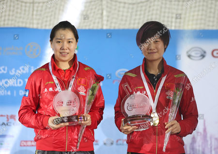China's Li Xiaoxia (l) and Ding Ning (r) Hold Their Trophys After Winning Against Chinese Taipei Huang Yi-hua and Cheng I-ching the Final of Women's Doubles at Gac Group Ittf World Tour Grand Finals at Al-nasr Club in Gulf Emirate of Dubai United Arab Emirates on 12 January 2014 United Arab Emirates Dubai