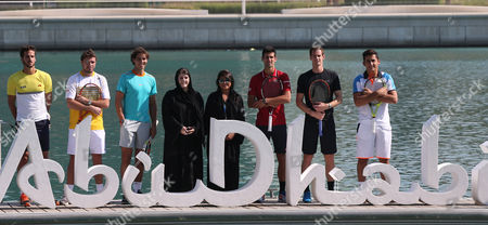 From (l-r) Spanish Tennis Player Feliciano Lopez Swiss Player Stanislas Wawrinka Spain's Rafael Nadal Nadine Saleh Hassan the Mubadala Head of Social Development and Partnerships Mubadala Communications Officer Dana Al-suweidi Serbian Player Novak Djokovic Andy Murray of Britain and Spanish Player Nicolas Almagro Pose During a Photocall at the Beach Rotana in Abu Dhabi As Part of the Mubadala World Tennis Championship 2014 in Abu Dhabi United Arab Emirates 01 January 2015 the Mubadala World Tennis Championship 2014 Will Continue Until 03 January 2015 Epa/ali Haider United Arab Emirates Abu Dhabi