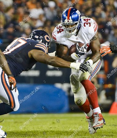 New York Giants Running Back Brandon Jacobs (r) Runs Past Chicago Bears Tackle Landon Cohen (l) For a Three Yard Gain in the Third Quarter of Their Nfl Game at Soldier Field in Chicago Illinois Usa 10 October 2013 the Bears Handed the Giants Their Sixth Straight Loss of the Season United States Chicago