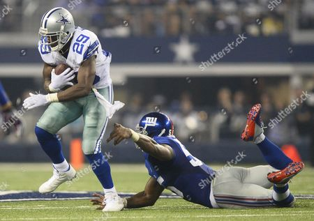 Dallas Cowboys Player Demarco Murray (l) Runs the Ball Against New York Giants Player Keith Rivers (r) in the First Half of Their Game at At&t Stadium in Arlington Texas Usa 08 September 2013 United States Arlington