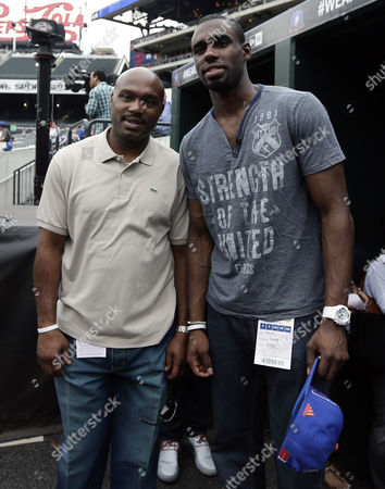 New York Knicks First Round Draft Pick Tim Hardaway Jr (l) Stands with His Dad Tim Hardaway Sr (r) on the Field Before the Start of Mlb Game Between the Washington Nationals Vs New York Mets at Citi Field in Flushing Meadows New York Usa 28 June 2013 United States Queens
