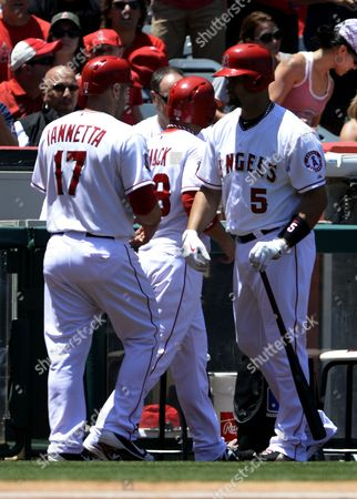Dominican Player Albert Pujols (r) Heads out to the Batters Box As Teammates Chris Iannetta (l) and J B Shuck (c) Head to the Dugout After Scoring in the Third Inning Against the Chicago White Sox at Angel Stadium in Anaheim California Usa 19 May 2013 United States Anaheim