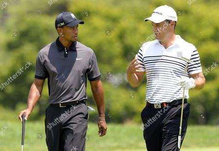 Tiger Woods (l) of the Us Speaks with Simon Khan of England While Walking Up to the First Green During a Practice Round at the 2013 Us Open Championship at Merion Golf Club in Ardmore Pennsylvania Usa 11 June 2013 the 2013 Us Open Will Be Played 13 June Through 16 June 2013 United States Ardmore