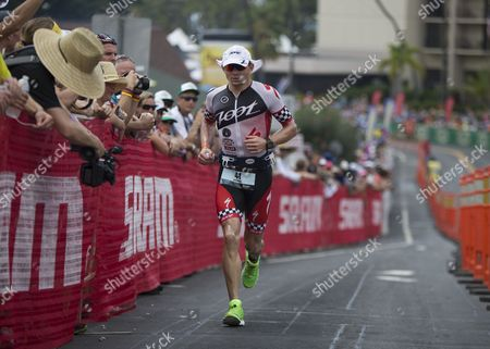 Ben Hoffman of the Usa Runs Up Palani Road During the Marathon and Final Leg of the Ironman World Championship in Kailua-kona Hawaii 11 October 2014 United States Kailua-kona