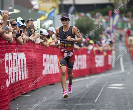 Rachel Joyce of Britain Runs Up Palani Road to Begin the Marathon and Final Leg of the Ironman World Championship in Kailua-kona Hawaii 11 October 2014 United States Kailua-kona