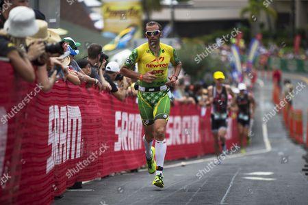 Chris Mcdonald of the Usa Runs Up Palani Road to Begin the Marathon and Final Leg of the Ironman World Championship in Kailua-kona Hawaii 11 October 2014 United States Kailua-kona