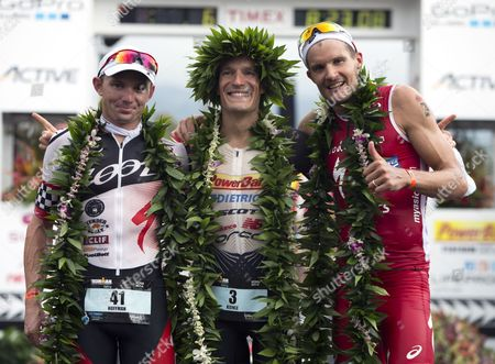 Ironman Men's Champion Sebastian Kienle (c) of Germany is Flanked by Runner Up Ben Hoffman of the Usa (l) and Third Place Finisher and Fellow German Jan Frodeno (r) at the 2014 Ironman World Championship in Kailua Kona Hawaii Usa 11 October 2012 the Ironman Competition Challenges Competitors with a 3 9 Km Swim Followed by a 180 Km Bike Ride and is Finished with a Marathon (42 195 Km) Run United States Kailua-kona