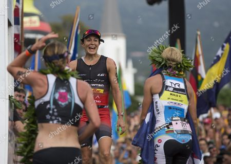 Women's Champion Mirinda Cafrae of Australia (r) and Runner Up Daniela Ryf of Switzerland (l) Greet Rachel Joyce (c) of the Uk As She Crosses the Finish Line For Third Place at the 2014 Ironman World Championship in Kailua Kona Hawaii Usa 11 October 2012 the Ironman Competition Challenges Competitors with a 3 9 Km Swim Followed by a 180 Km Bike Ride and is Finished with a Marathon (42 195 Km) Run United States Kailua-kona