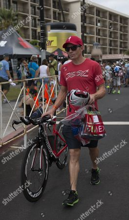 Ben Hoffman of the Usa Approaches the Bike Check in at the Kailua Pier Transition Area During the Ironman World Championship Being Held at Kailua-kona Hawaii Usa 10 October 2014 the Ironman Competition Challenges Competitors with a 3 9 Km Swim Followed by a 180 Km Bike Ride and Finished with a Marathon (42 195 Km) Run United States Kailua-kona