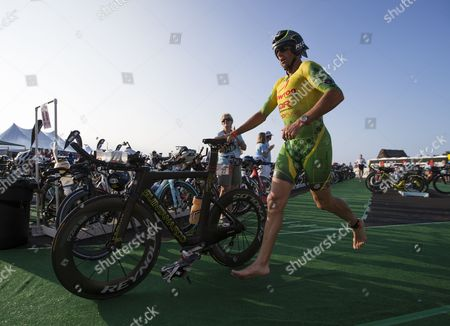 Chris Mcdonald of the Usa Races out of the Transition Area on Kailua Pier to Begin the Cycling Leg of the Ironman World Championship Race Held at Kailua-kona Hawaii Usa 11 October 2014 United States Kailua-kona