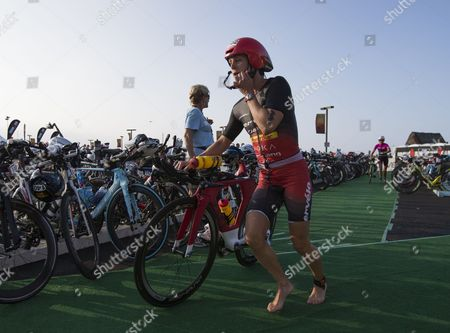 Rachel Joyce of the Uk Races out of the Transition Area on Kailua Pier to Begin the Cycling Leg of the Ironman World Championship Race Held at Kailua-kona Hawaii Usa 11 October 2014 United States Kailua-kona