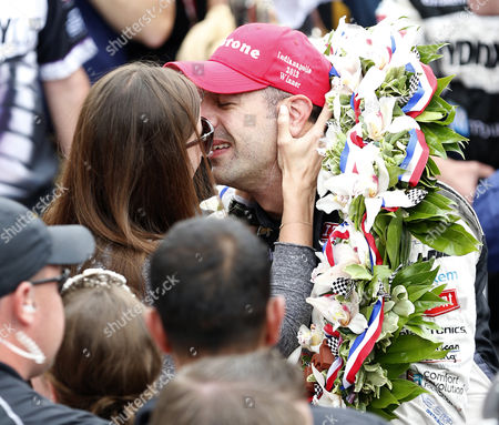 Stock Photo of Tony Kanaan of Brazil (r) Kisses His Wife Lauren Bohlander Kanaan (l) After Winning the 97th Running of the Indianapolis 500 Auto Race at the Indianapolis Motor Speedway in Indianapolis Indiana Usa 26 May 2013 United States Indianapolis