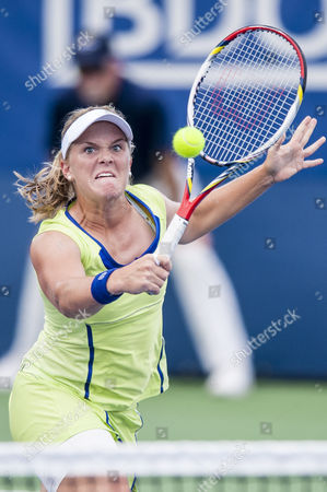 Usa's Melanie Oudin Hits a Return to Germany's Angelique Kerber During Their Women's Singles Match at the Citi Open Atp Tennis Tournament in Washington Dc Usa 1 Aug 2013 Kerber Won the Match 7-5 6-0 to Advance United States Washington