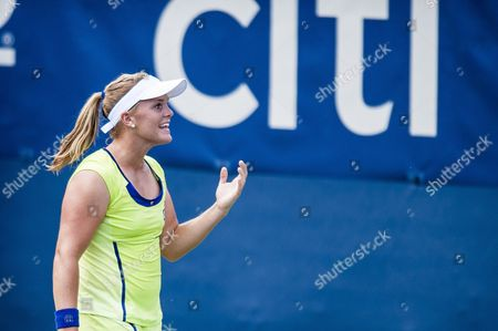 Stock Photo of Usa's Melanie Oudin Hits a Return to Germany's Angelique Kerber During Their Women's Singles Match at the Citi Open Atp Tennis Tournament in Washington Dc Usa 01 August 2013 Kerber Won the Match 7-5 6-0 to Advance United States Washington
