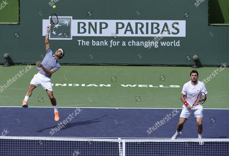 Roger Federer of Switzerland (l) Hits an Overhead Smash As Stanislas Wawrinka of Switzerland (r) Looks on Against Against Rohan Bopanna of India and Aisam-ul-haq Qureshi of Pakistan During Their Doubles Match at the Bnp Paribas Open Tennis in Indian Wells California Usa 07 March 2014 United States Indian Wells