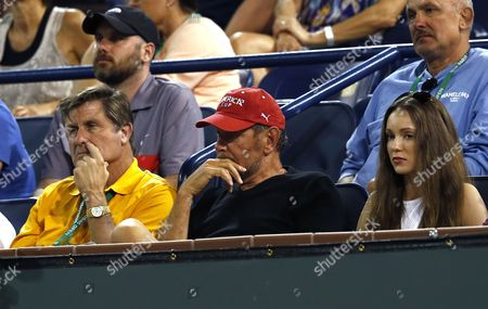 Larry Ellison (c) Ceo and Co-founder of Oracle Corporation and Owner of the Indian Wells Tennis Garden and Charlie Pasarell (l) Founder of the Indian Wells Tennis Garden Watch the Match Between Rafael Nadal of Spain and Alexandr Dolgopolov of the Ukraine Next to Ukrainian Actress Nikita Kahn (r) at the Bnp Paribas Open Tennis in Indian Wells California Usa 10 March 2014 United States Indian Wells