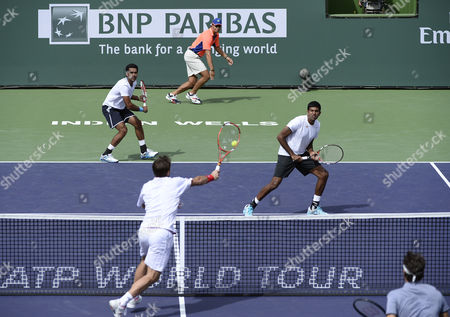 Stanislas Wawrinka of Switzerland (bottom-l) Volleys As Roger Federer of Switzerland (bottom-r) Looks on Against Rohan Bopanna of India (top-r) and Aisam-ul-haq Qureshi of Pakistan (top-l) During Their Doubles Match at the Bnp Paribas Open Tennis in Indian Wells California Usa 07 March 2014 United States Indian Wells