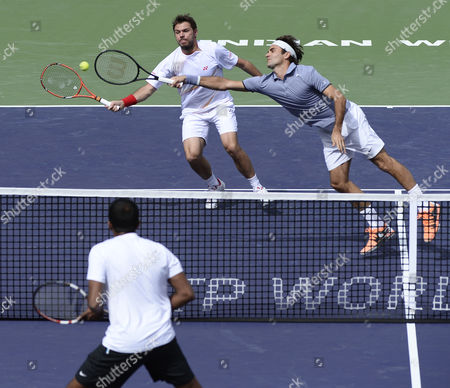 Roger Federer (r) and Stanislas Wawrinka (c) of Switzerland Reach out to Volley Against Rohan Bopanna of India (l) and Aisam-ul-haq Qureshi of Pakistan (not Shown) During Their Doubles Match at the Bnp Paribas Open Tennis in Indian Wells California Usa 07 March 2014 United States Indian Wells