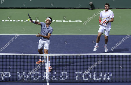 Roger Federer of Switzerland (l) Volleys As Stanislas Wawrinka of Switzerland (r) Looks on Against Against Rohan Bopanna of India and Aisam-ul-haq Qureshi of Pakistan During Their Doubles Match at the Bnp Paribas Open Tennis in Indian Wells California Usa 07 March 2014 United States Indian Wells