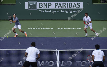 Roger Federer of Switzerland (top-l) Sets-up to Return As Stanislas Wawrinka (top-r) of Switzerland Looks on Against Rohan Bopanna of India (l) and Aisam-ul-haq Qureshi of Pakistan (r) During Their Doubles Match at the Bnp Paribas Open Tennis in Indian Wells California Usa 07 March 2014 United States Indian Wells