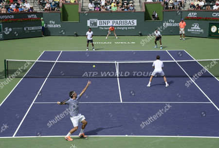 Roger Federer of Switzerland Serves Against Rohan Bopanna of India (top-r) and Aisam-ul-haq Qureshi of Pakistan (top-l) As Stanislas Wawrinka of Switzerland (bottom-r) Looks on During Their Doubles Match at the Bnp Paribas Open Tennis in Indian Wells California Usa 07 March 2014 United States Indian Wells