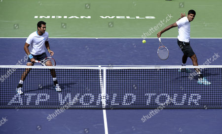 Rohan Bopanna of India (r) Volleys As Aisam-ul-haq Qureshi of Pakistan (l) Looks on Against Stanislas Wawrinka and Roger Federer of Switzerland During Their Doubles Match at the Bnp Paribas Open Tennis in Indian Wells California Usa 07 March 2014 United States Indian Wells