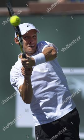 Nikolay Davydenko of Russia Returns a Shot to John Isner of the Usa During Their Match at the Bnp Paribas Open in Indian Wells California Usa 09 March 2014 Isner Won the Match United States Indian Wells