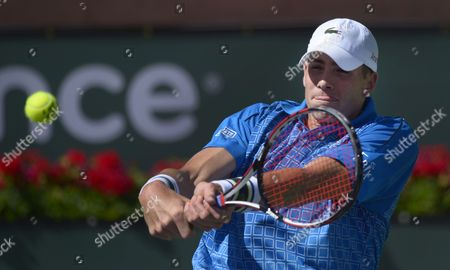 John Isner of the Usa Returns a Shot to Nikolay Davydenko of Russia During Their Match at the Bnp Paribas Open in Indian Wells California Usa 09 March 2014 Isner Won the Match United States Indian Wells
