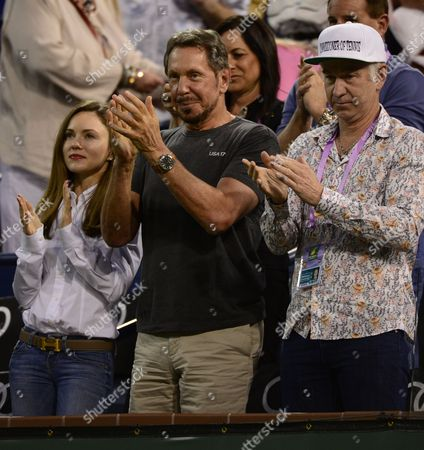 Tech Entrepreneur Larry Ellison (c) His Girlfriend Nikita Kahn (l) and Tennis Legend John Mcenroe (r) As Serena Williams of the Usa is Cheered As She Enters the Court Prior to Her Match Against Monica Niculescu of Romania During Their Second Round Match at the Bnp Paribas Open Tennis Tournament in Indian Wells California Usa 13 March 2015 Serena Williams is Returning to Play at India Wells After Boycotting the Tournament For 14 Years United States Indian Wells