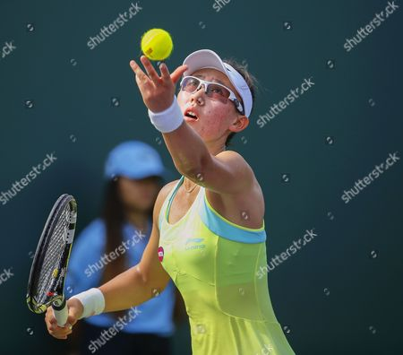 Saisai Zheng of China Serves the Ball to Michelle Larcher De Brito of Portugal During Their Qualifying Round Match of the Miami Open Tennis Tournament at the Crandon Park Tennis Center on Key Biscayne in Miami Florida Usa 23 March 2015 United States Miami