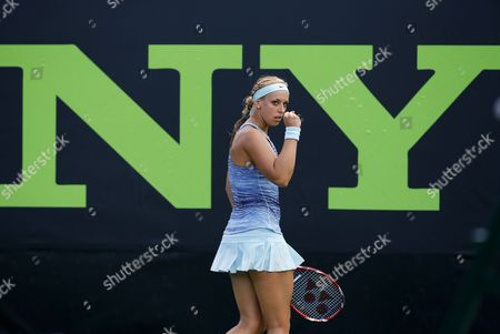 Stock Image of Sabine Lisicki of Germany Celebrates Winning a Point Over Nadia Petrova of Russia During a Match at the Sony Open Tennis Tournament on Key Biscayne in Miami Florida Usa 20 March 2014 United States Miami