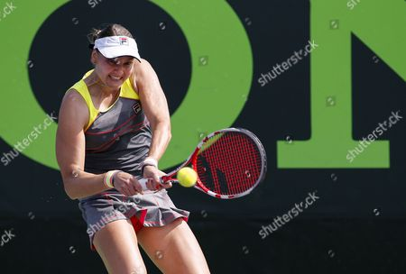 Stock Photo of Nadia Petrova of Russia Returns the Ball to Sabine Lisicki of Germany During a Match at the Sony Open Tennis Tournament on Key Biscayne in Miami Florida Usa 20 March 2014 Lisicki Won the Match United States Miami