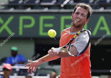 Adrian Mannarino of France Returns a Shot From Nikolay Davydenko of Russia During a First Round Match at the Sony Open Tennis Tournament on Key Biscayne in Miami Florida Usa 19 March 2014 United States Miami