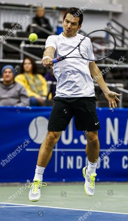 Stock Photo of Bjoern Phau of Germany Hits a Return to Ryan Harrison of the Us in Their First Round Match in the Us National Indoor Tennis Championships at the Racquet Club of Memphis in Memphis Tennessee Usa 11 February 2014 United States Memphis
