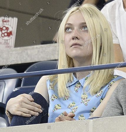 Us Actress Dakota Fanning (l) and Boyfriend Jamie Strachan (not Visible) Watch As Daniela Hantuchova of Slovakia Plays Victoria Azarenka of Belarus During Their Quarterfinals Round Match on the Tenth Day of the 2013 Us Open Tennis Championship at the Usta National Tennis Center in Flushing Meadows New York Usa 04 September 2013 the Us Open Runs Through Monday 09 September a 15-day Schedule For the First Time United States Flushing Meadows