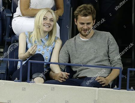 Us Actress Dakota Fanning (l) and Boyfriend Jamie Strachan (r) Watch As Daniela Hantuchova of Slovakia Plays Victoria Azarenka of Belarus During Their Quarterfinals Round Match on the Tenth Day of the 2013 Us Open Tennis Championship at the Usta National Tennis Center in Flushing Meadows New York Usa 04 September 2013 the Us Open Runs Through Monday 09 September a 15-day Schedule For the First Time United States Flushing Meadows