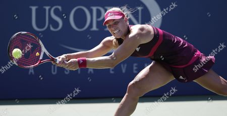 Stock Photo of Angelique Kerber of Germany Hits a Return to Ksenia Pervak of Russia During the 2014 Us Open Tennis Championship at the Usta National Tennis Center in Flushing Meadows New York Usa 25 August 2014 the Us Open Runs Through Monday 08 September a 15-day Schedule United States Flushing Meadows