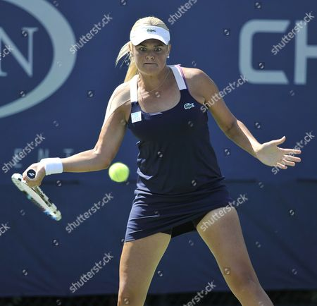Aleksandra Wozniak of Canada Hits a Return to Kurumi Nara of Japan During the 2014 Us Open Tennis Championship at the Usta National Tennis Center in Flushing Meadows New York Usa 25 August 2014 the Us Open Runs Through Monday 08 September a 15-day Schedule United States Flushing Meadows