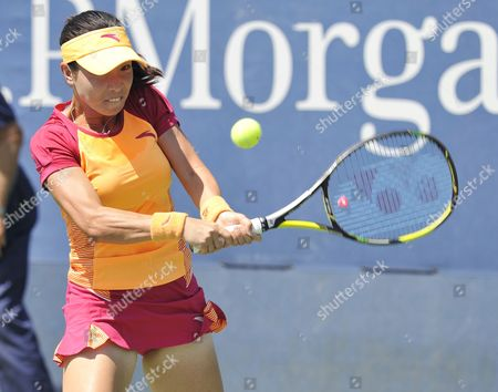 Jie Zheng of China Hits a Return to Shuai Peng of China During the 2014 Us Open Tennis Championship at the Usta National Tennis Center in Flushing Meadows New York Usa 25 August 2014 the Us Open Runs Through Monday 08 September a 15-day Schedule United States Flushing Meadows
