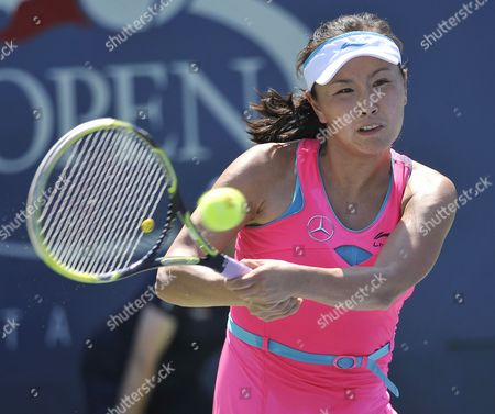 Stock Picture of Shuai Peng of China Hits a Return to Jie Zheng of China During the 2014 Us Open Tennis Championship at the Usta National Tennis Center in Flushing Meadows New York Usa 25 August 2014 the Us Open Runs Through Monday 08 September a 15-day Schedule United States Flushing Meadows