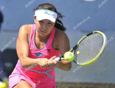 Stock Image of Shuai Peng of China Hits a Return to Jie Zheng of China During the 2014 Us Open Tennis Championship at the Usta National Tennis Center in Flushing Meadows New York Usa 25 August 2014 the Us Open Runs Through Monday 08 September a 15-day Schedule United States Flushing Meadows