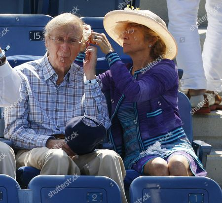 Stock Picture of Us Actor Gene Wilder (l) Has Sun Block Applied by His Wife Karen Boyer (r) As They Watch Novak Djokovic of Serbia Play Kei Nishikori of Japan During Their Semifinals Round Match on the Thirteenth Day of the 2014 Us Open Tennis Championship at the Usta National Tennis Center in Flushing Meadows New York Usa 06 September 2014 the Us Open Runs Through 08 September a 15-day Schedule United States Flushing Meadows