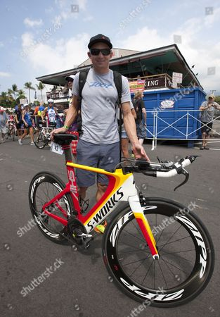 Ben Hoffman of the Usa Enters the Transition Compound to Check in His Bike For the Ironman World Championships 2013 in Kailua-kona Hawaii Usa 11 October 2013 the Triathlon 2013 Ironman World Championships Will Take Place on 12 October 2013 United States Kailua-kona