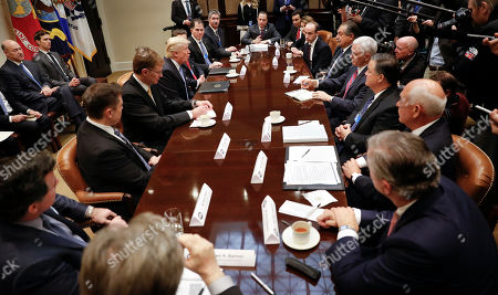 Donald Trump, Reince Priebus, Mark Fields, Marillyn A. Hewson, Stephen Miller, Andrew Liveris, Mike Pence, Mark Sutton, Jeff Fettig, Klaus Kleinfeld, Steve Bannon, Kevin Plank, Elon Musk, Wendell P. Weeks, Alex Gorsky Michael S. Dell, Mario Longhi President Donald Trump, left center, host breakfast with business leaders in the Roosevelt Room of the White House in Washington, . At the meeting starting from the top going clockwise, White House Chief of Staff Reince Priebus, Mark Fields from Ford Motor Company, Marillyn A. Hewson from Lockhead Martin, White House Policy Adviser Stephen Miller, Andrew Liveris from Dow Chemicals, Vice President Mike Pence, Mark Sutton from International Paper, Jeff Fettig from Whirlpool, Klaus Kleinfeld from Arconic, White House Senior Adviser Steve Bannon, left, Kevin Plank from Under Armour, Elon Musk from Telsa and SpaceX, Wendell P. Weeks from Corning, President Trump, Alex Gorsky from Johnson & Johnson, Michael S. Dell from Dell Technologies and Mario Longhi from US Steel
