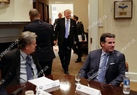 Donald Trump, Steve Bannon, Kevin Plank President Donald Trump smiles as he walks in from the Oval Office of the White House in Washington, to host breakfast with business leaders in the Roosevelt Room. Sitting at the table are White House Senior Adviser Steve Bannon, left, and Kevin Plank, founder, CEO and Chairman of Under Armour