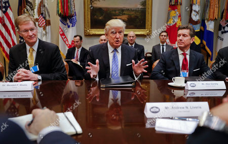 Donald Trump, Alex Gorsky, Wendell P. Weeks President Donald Trump speaks while hosting a breakfast with business leaders in the Roosevelt Room of the White House in Washington, . At left is Wendell P. Weeks, Chief Executive Officer of Corning, at right is Alex Gorsky Chairman and Chief Executive Officer of Johnson & Johnson
