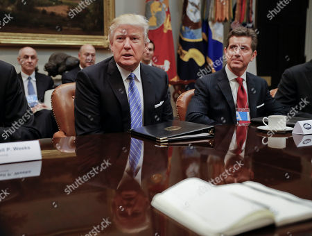 Donald Trump, Alex Gorsky President Donald Trump speaks while hosting a breakfast with business leaders in the Roosevelt Room of the White House in Washington, . At left is Alex Gorsky, chairman and chief executive officer of Johnson & Johnson