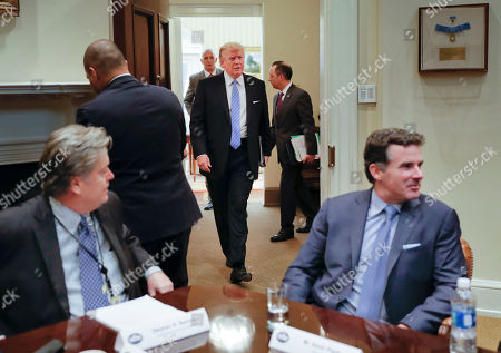 Donald Trump, Steve Bannon, Kevin Plank President Donald Trump walks in from the Oval Office of the White House in Washington in Washington, before hosting breakfast with business leaders in the Roosevelt Room. Sitting at the table is White House Senior Adviser Steve Bannon, left, and Kevin Plank, founder, CEO and Chairman of Under Armour